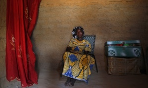 In this picture taken Friday, July 20, 2012, Aicha, 14, poses in her bedroom in the remote village of Kaihi Niger. Originally from Hawkantaki, Aicha has been married for seven months. Niger has one of the highest rates of child marriage in the world.  (AP Photo/Jerome Delay)